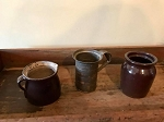 Antique brown pottery pitcher is 5