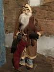 Arnett's Santa Wearing Brown Homespun Coat Holding Gingerbread Man and Stocking 21
