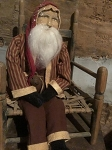 Arnett's Medium Sitting Santa Wearing Red Ticking Coat 24