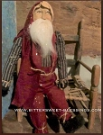 Arnett's Sitting Santa Wearing Red Overalls and Navy Striped Shirt 24