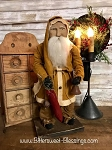 Arnett's Santa Mustard Coat Holding Stocking and Bell 19