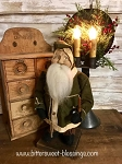 Arnett's Belsnickle Santa Holding a Candle with Green Coat 15